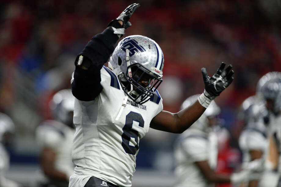 West Orange-Stark's Justin Brown celebrates after scoring a touchdown during the fourth quarter Sweetwater in the Class 4A-Division II state final at AT&T Stadium in Dallas on Friday. Photo taken Friday 12/16/16 Ryan Pelham/The Enterprise Photo: Ryan Pelham / ©2016 The Beaumont Enterprise/Ryan Pelham