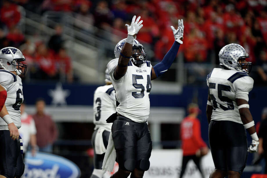 West Orange-Stark's Te'ron Brown celebrates a touchdown during the fourth quarter against Sweetwater in the Class 4A-Division II state final at AT&T Stadium in Arlington on Friday. Photo taken Friday 12/16/16 Ryan Pelham/The Enterprise Photo: Ryan Pelham / ©2016 The Beaumont Enterprise/Ryan Pelham