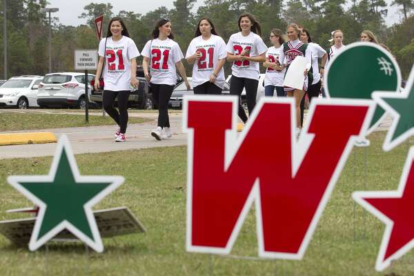 Students wearing No. 21 t-shirts in support of injured linebacker Grant Milton make their way toward during a send-off rally for The Woodlands High School varsity football team Saturday, Dec. 17, 2016, in The Woodlands. Milton was injured during the team's state playoff game against Austin Bowie on Nov. 26 at McLane Stadium on the campus of Baylor University. After brain surgery and 17 days in a Waco hospital, Milton was transferred to a medical facility in The Woodlands Nov. 13. The Highlanders travel to AT&T Stadium in Arlington to face Lake Travis in the Class 6A Division I state title game at 8 p.m. Saturday.