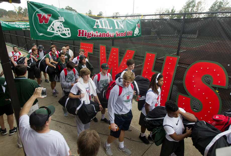 Members of The Woodlands High School varsity football team make their way through supporters during a send-off rally Saturday, Dec. 17, 2016, in The Woodlands. The Highlanders travel to AT&T Stadium in Arlington to face Lake Travis in the Class 6A Division I state title game at 8 p.m. Saturday. Photo: Jason Fochtman/Houston Chronicle