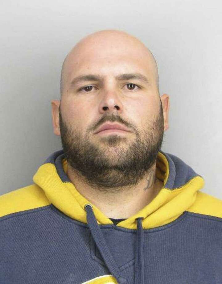Daniel Orte ga, 31, was ar rested in the killing of a Rich mond musician at a pool hall. Photo: Contra Costa County Sheriff's Office / Contra Costa County Sheriff's Office