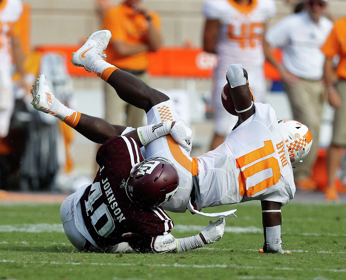Texas A&M Aggies defensive lineman Jarrett Johnson (40) tackles Tennessee Volunteers wide receiver Tyler Byrd (10) during the second quarter of a college football game at Kyle Field, Saturday, Oct. 8, 2016 in College Station. ( Karen Warren / Houston Chronicle )