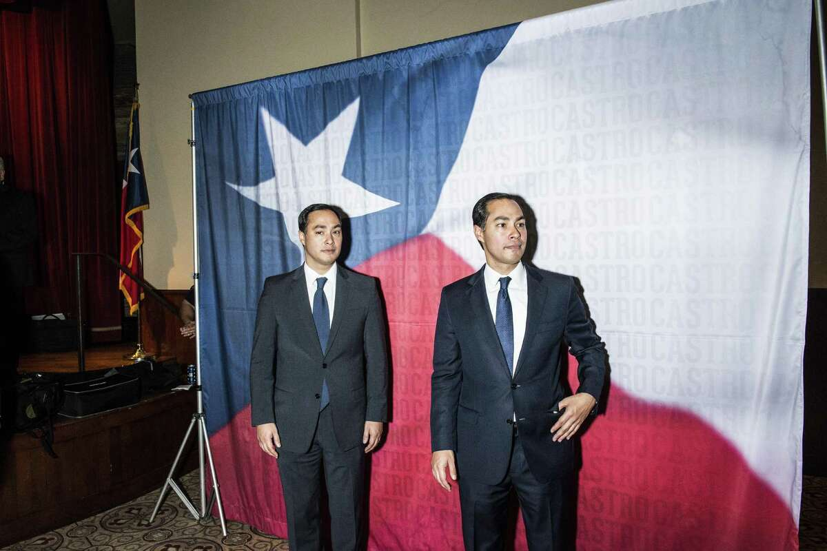 Brothers Joaquin, left, and Julian Castro, right, wait to take photographs with well-wishers during a birthday party for the brothers on Friday, September 16, 2016 in San Antonio, Texas. The brothers Castro spent part of their Christmas holiday attacking President-elect Donald Trump on social media.