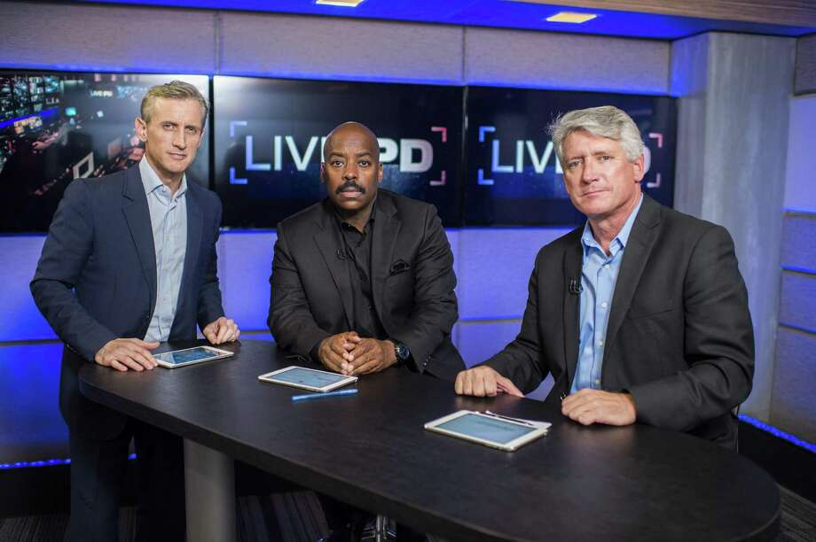 Live PD hosts Dan Abrams, Kevin Jackson and Rich Emberlin in the studio in New York. The new A&E series will capture the work of a varied mix of urban and rural police forces around the country on a typical Friday evening, including Bridgeport cops. Photo: Contributed Photo / Contributed Photo / Connecticut Post Contributed