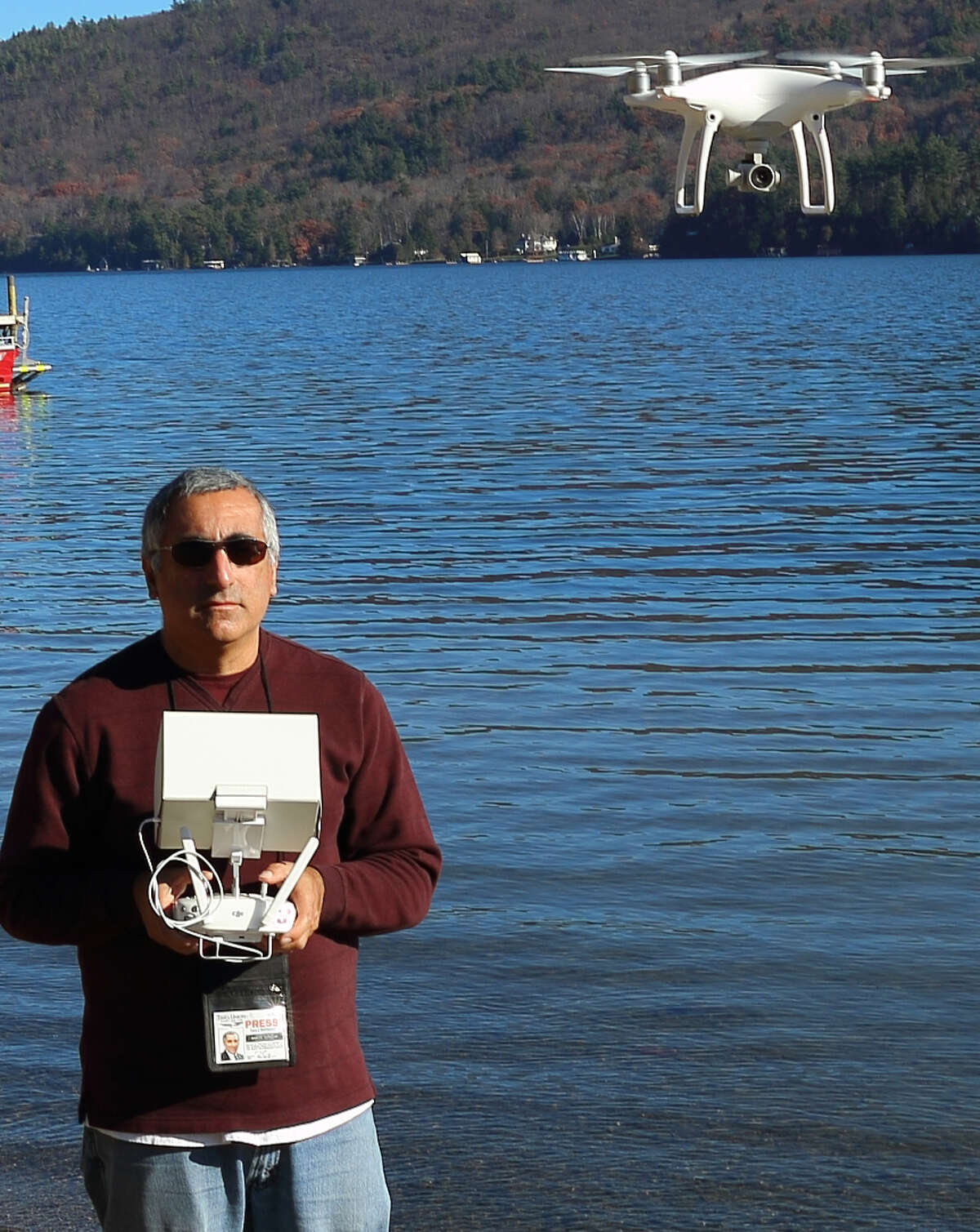 Gary McPherson, the first commercially-licensed aerial drone pilot in the Capitol Region, uses his drone to take pictures of the polar plunge event at Lake George last month.