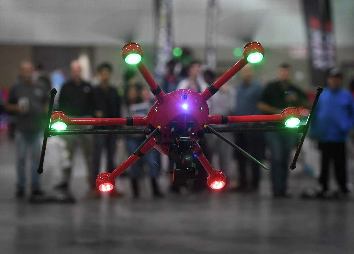 People watch a model T60 drone made by the Chinese JTT firm, maneuver an obstacle couse during the International Drone Expo in Los Angeles, California on December 10, 2016 The two day expo is open to the general public and aims to discuss how this technology can be safely utilized for business, health, public safety, urban planning, entertainment and other commercial purposes. (MARK RALSTON/AFP/Getty Images)