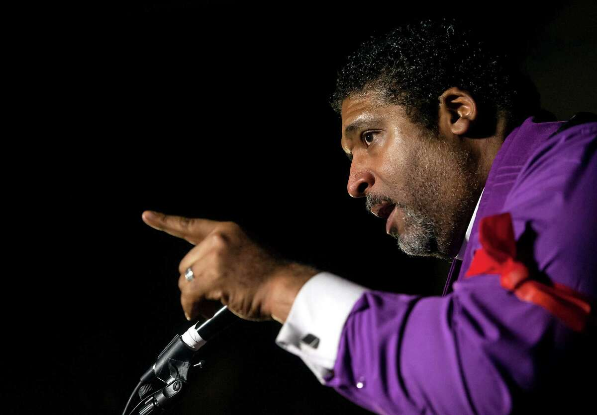 """Rev. Dr. William Barber, President of the North Carolina NAACP, addresses a crowd during a """"Fight for 15"""" rally on Nov. 29, 2016 in Durham, NC. The rally brought together employees of the fast food, home care and child care industries to demand a $15 minimum wage. (Kaitlin McKeown/The Herald-Sun via AP)"""