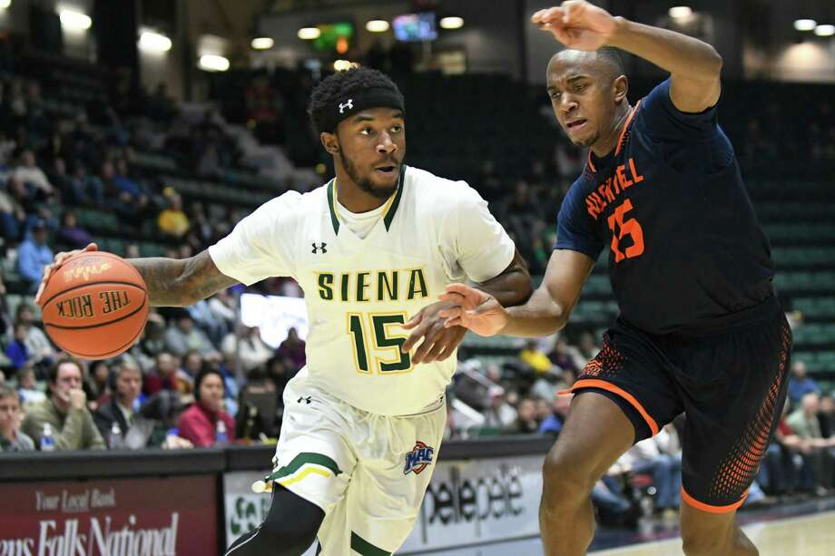 Siena's Nico Clareth, center, drives the ball as Bucknell's Nate Jones defends during their basketball game on Saturday, Dec. 17, 2016, at Glens Falls Civic Center in Glens Falls, N.Y. (Cindy Schultz / Times Union) Photo: Cindy Schultz / Albany Times Union