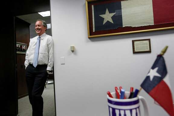 Texas Attorney General Ken Paxton has adorned his office with state symbols, including a signed Dallas Cowboys jersey.