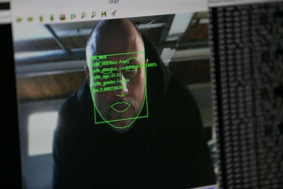 Trevor Paglen demonstrates one of the many facial recognition algorithms that will be used in his upcoming performance that will be held at Pier 70 on Friday, December 16, 2016 in San Francisco, Calif.