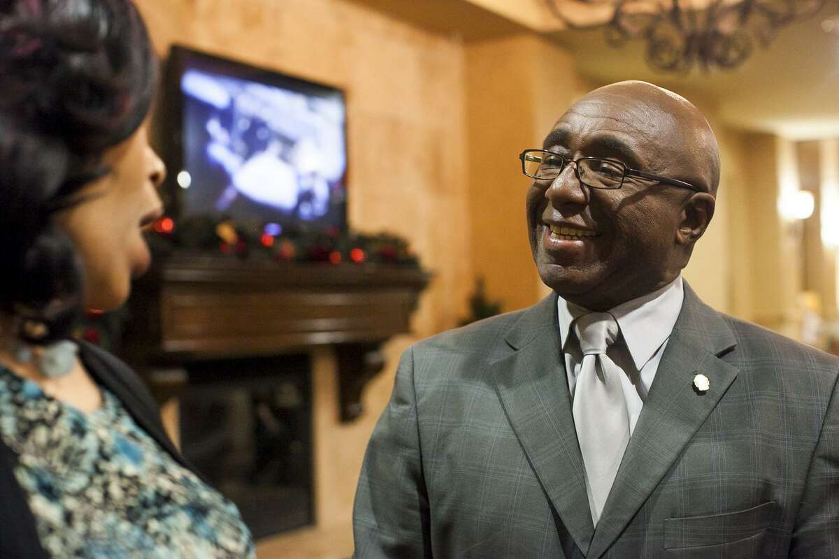 Keith Toney speaks with supporters Tuesday Dec. 9, 2014 at Comfort Suites, while waiting for results of the District 2 elections.