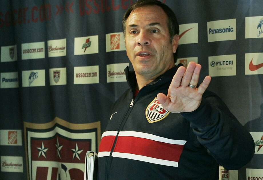 U.S. team manager Bruce Arena makes a final comment as he leaves a news conference in Hamburg, Germany, in advance of a match against Ghana in the 2006 World Cup. Arena is returning to coach the U.S. national team, a decade after he was fired. Photo: Elise Amendola /Associated Press / Copyright 2016 The Associated Press. All rights reserved.