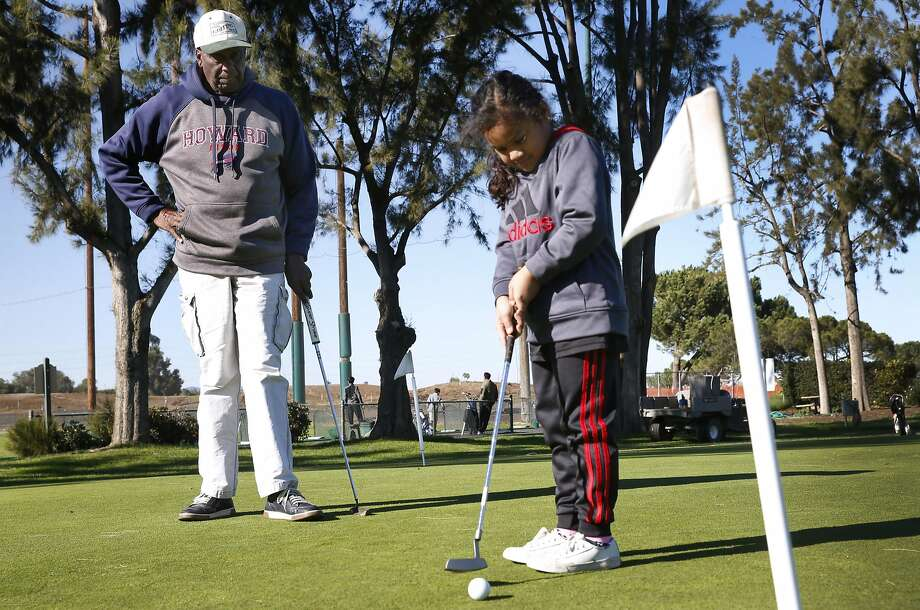 Bob Hoover teaches the game of golf to youths at the municipal golf course in Palo Alto. Soon to be 85 years old, he founded the East Palo Alto Junior Golf Program in 1991, and it now bears his name. Photo: Paul Chinn, The Chronicle