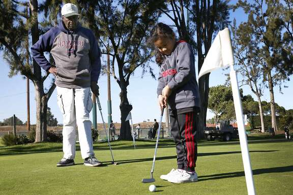 Bob Hoover teaches the game of golf to youths at the municipal golf course in Palo Alto, Calif. on Saturday, Dec. 17, 2016. Hoover founded the East Palo Alto Junior Golf program 25 years ago.
