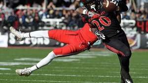 San Diego State running back Rashaad Penny (20) runs with the ball against Houston cornerback Howard Wilson (6) during the first half of the Las Vegas Bowl NCAA college football game on Saturday, Dec. 17, 2016, in Las Vegas. (AP Photo/David Becker)