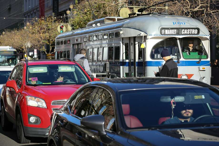 A Lyft car navigates through traffic on Market Street in San Francisco. A think tank study found Lyft rides more efficient. Photo: Amy Osborne, Special To The Chronicle