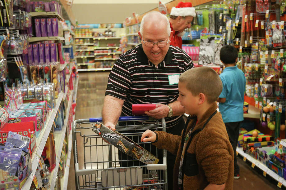 Panorama Village Samaritan George Jackson, left, takes Gabriel Crowell, 8, shopping for toys on Saturday, Dec. 17, 2016, at the Kroger Marketplace in Willis. Photo: Michael Minasi, Staff / © 2016 Houston Chronicle