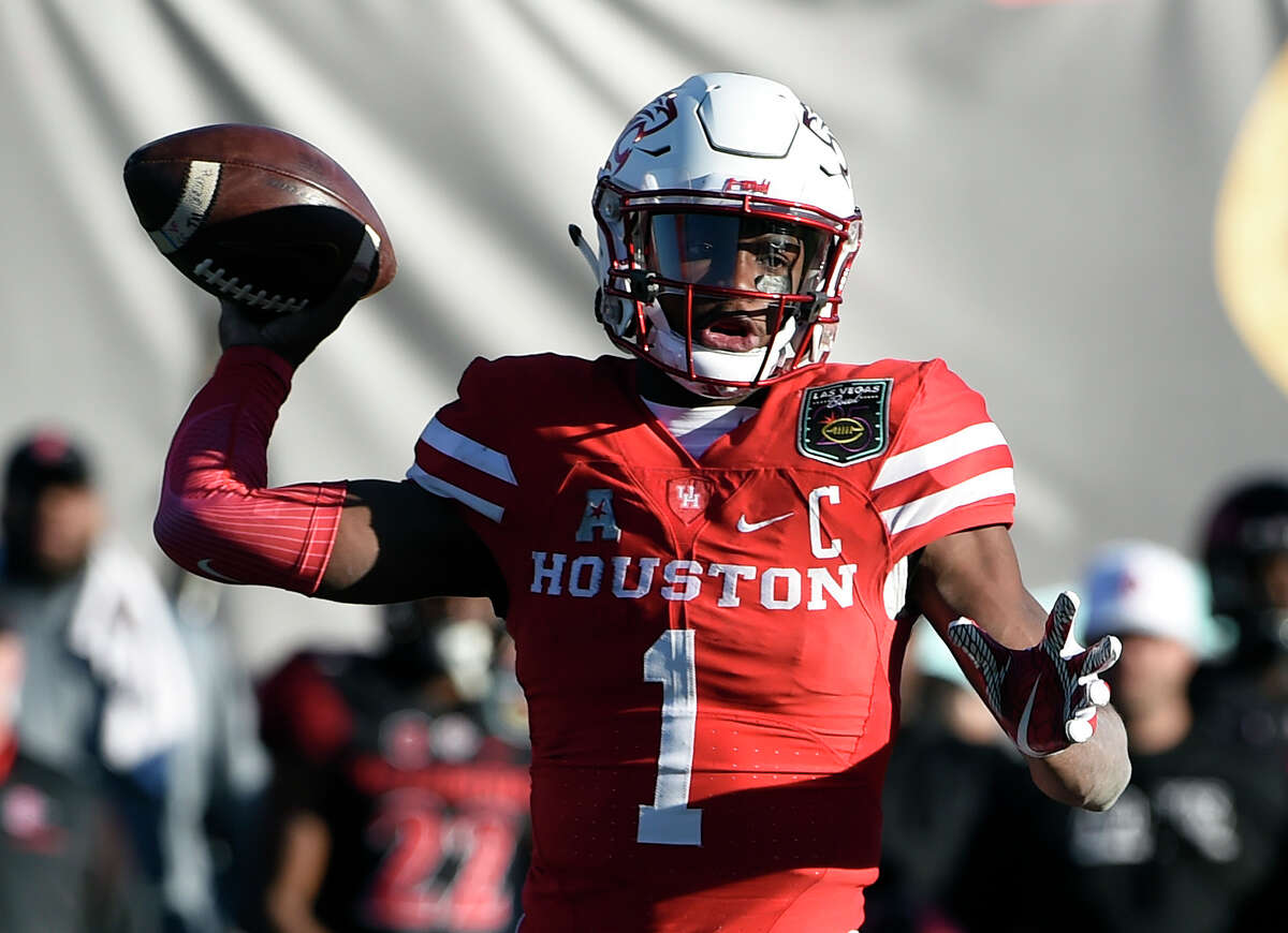 Houston quarterback Greg Ward Jr. looks to pass against San Diego State during the second half of the Las Vegas Bowl NCAA college football game Saturday, Dec. 17, 2016, in Las Vegas. San Diego State won 34-10. (AP Photo/David Becker)