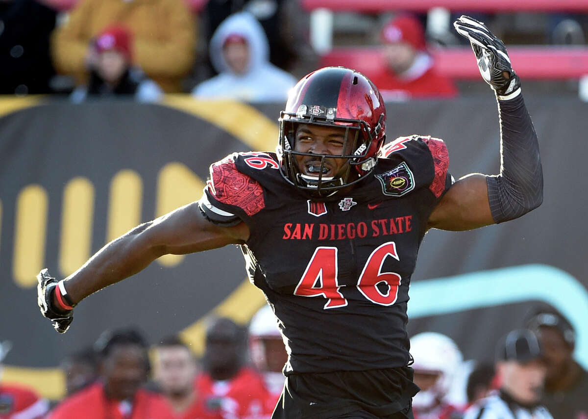 San Diego State defensive lineman Jay Henderson (46) reacts after sacking Houston quarterback Greg Ward Jr. during the second half of the Las Vegas Bowl NCAA college football game on Saturday, Dec. 17, 2016, in Las Vegas. San Diego State won 34-10. (AP Photo/David Becker)