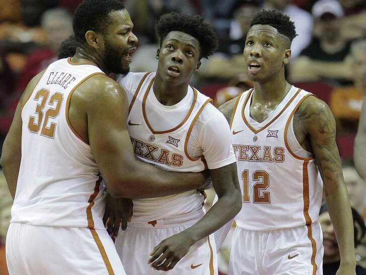 Texas Longhorns forward Shaquille Cleare (32), guard Andrew Jones (1) and guard Kerwin Roach Jr. (12) reacts to a call  at the Toyota Center on Saturday, Dec. 17, 2016, in Houston.  Arkansas won the game 77-74. ( Elizabeth Conley / Houston Chronicle )