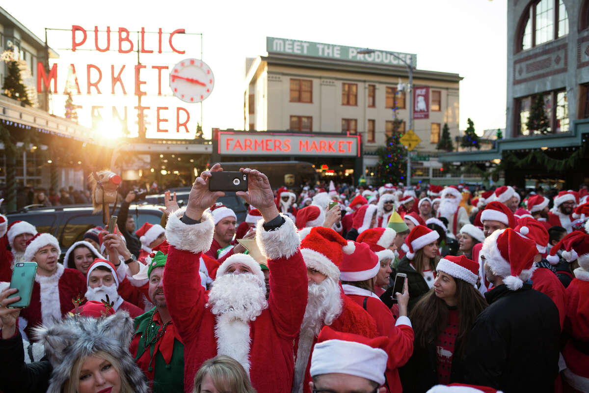Santas take over Pike Place Market during Seattle's annual SantaCon on Saturday, Dec. 17, 2016.