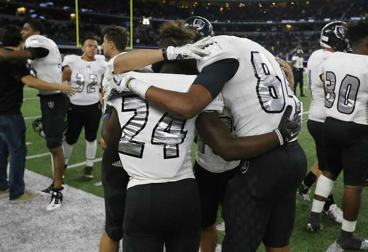 Steele players embrace after Saturday's loss to DeSoto in the Class 6A Division II championship game at AT&T Stadium.
