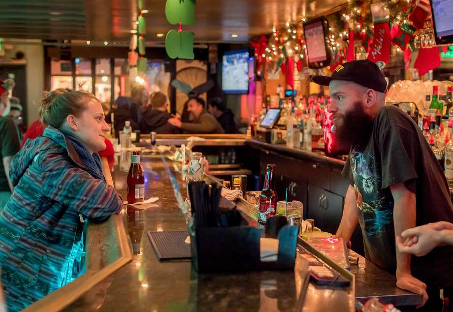 Bartender Ryan Sherman, above, talks with Tea Smith at the Mix in S.F. Left: Customers have drinks in a festive atmosphere. Photo: John Storey, Special To The Chronicle