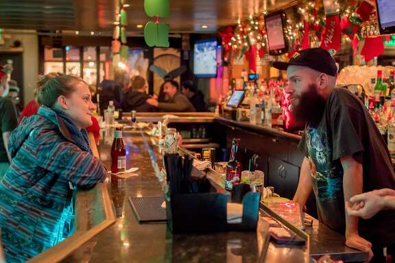 Bartender Ryan Sherman talks with Tea Smith at the Mix bar in San Francisco, Calif. on December 17th, 2016.