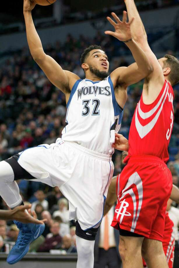 Minnesota Timberwolves center Karl-Anthony Towns (32) puts up a shot over Houston Rockets forward Ryan Anderson (3) during the first half of an NBA basketball game, Saturday, Dec. 17, 2016, in Minneapolis. (AP Photo/Paul Battaglia) Photo: Paul Battaglia, Associated Press / FR1768 AP