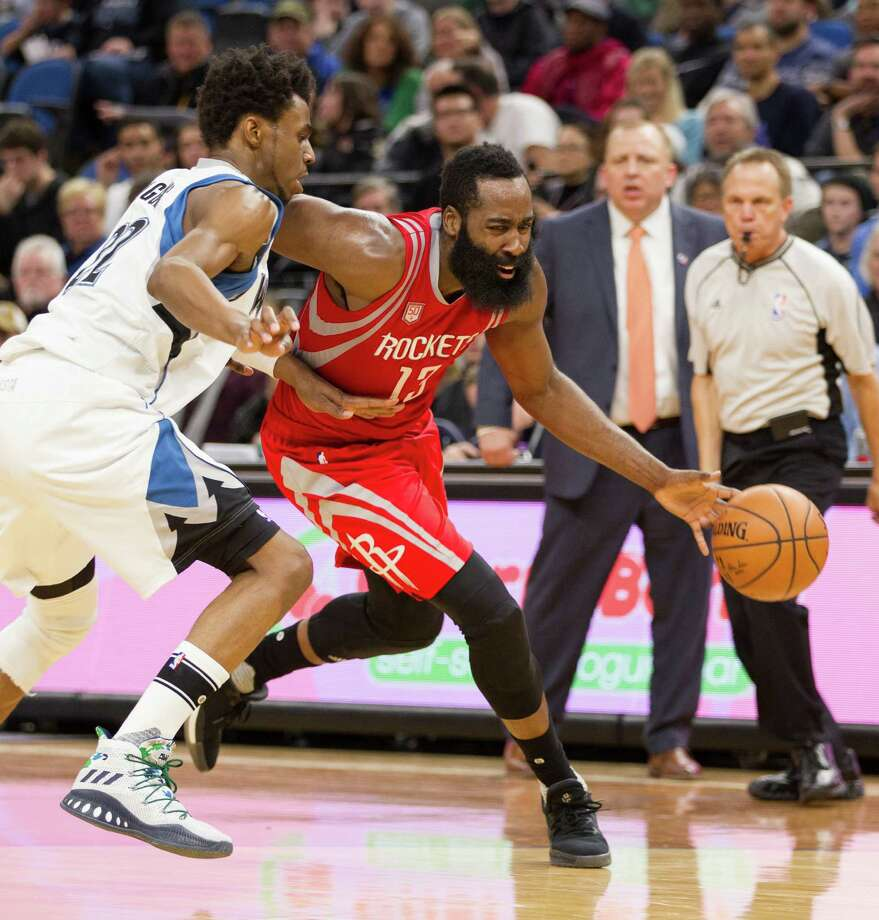 Houston Rockets guard James Harden (13) drives against Minnesota Timberwolves forward Andrew Wiggins (22) during the second half of an NBA basketball game, Saturday, Dec. 17, 2016, in Minneapolis. Harden had 28 points on the night as Houston won 111-109 in overtime. (AP Photo/Paul Battaglia) Photo: Paul Battaglia, Associated Press / FR1768 AP