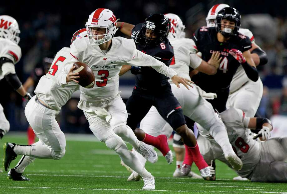 The Woodlands quarterback Eric Schmid (3) is forced out of the pocked after pressure by Lake Travis defensive back Aaron Brown-Nixon (6) and defensive linemen T.J. Simien (44) during the first quarter of a UIL Class 6A Division I state final at AT&T Stadium Saturday, Dec. 17, 2016, in Arlington. Photo: Jason Fochtman, Staff Photographer / Houston Chronicle