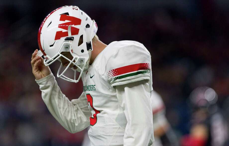 The Woodlands quarterback Eric Schmid (3) walks off the field after coming up short on third-and-15 during the first quarter of a UIL Class 6A Division I state final at AT&T Stadium Saturday, Dec. 17, 2016, in Arlington. Photo: Jason Fochtman, Staff Photographer / Houston Chronicle
