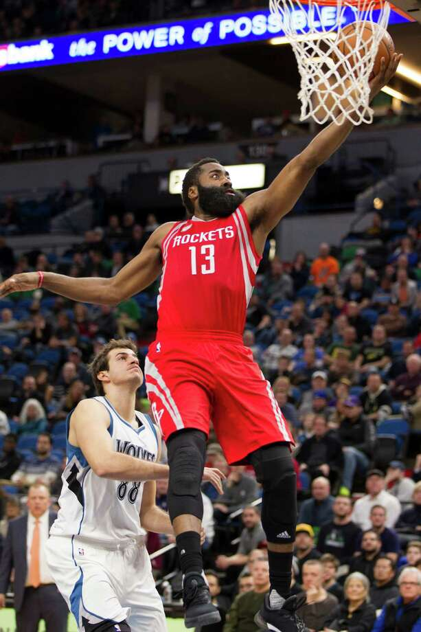 Houston Rockets guard James Harden (13) scores during the second half of an NBA basketball game as Minnesota Timberwolves forward Nemanja Bjelica (88), of Serbia looks on Saturday, Dec. 17, 2016, in Minneapolis. Houston won 111-109 in overtime. (AP Photo/Paul Battaglia) Photo: Paul Battaglia, Associated Press / FR1768 AP