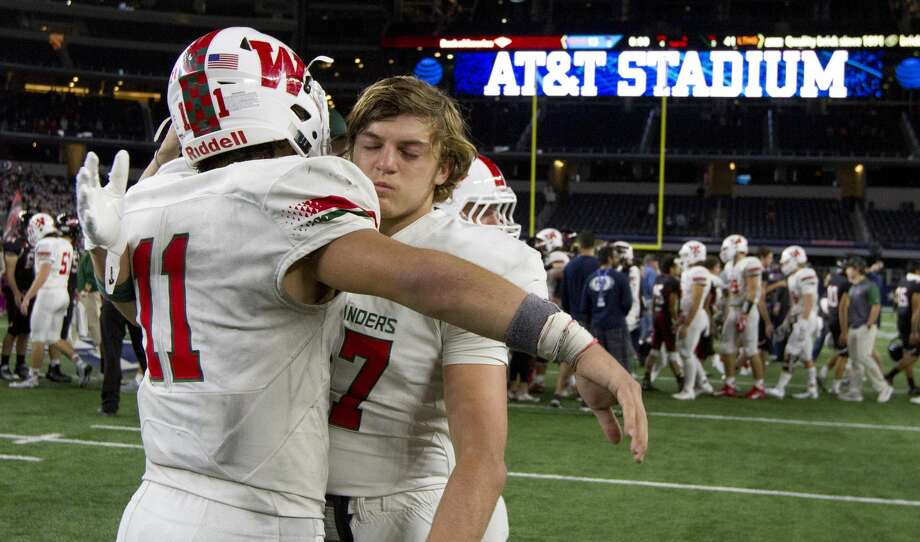 The Woodlands' Troy Kruchten (27) is consoled by Zach La Canfora (11) after losing to Lake Travis Lake 41-13 in a UIL Class 6A Division I state final at AT&T Stadium Saturday, Dec. 17, 2016, in Arlington. Photo: Jason Fochtman/Houston Chronicle