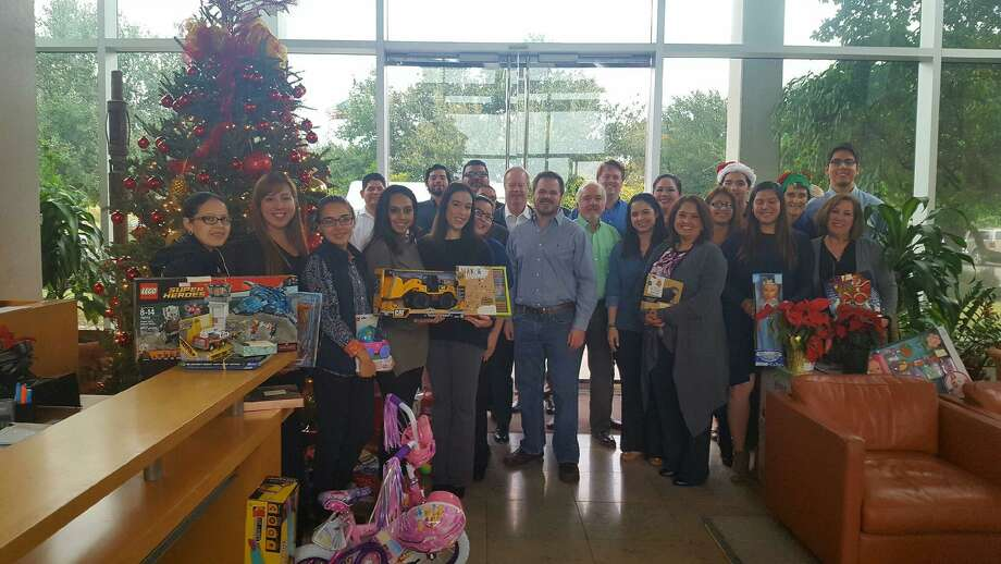 Pictured are the employees of Killam Oil and Killam Development that presented over 70 gifts to children in the care of Mercy Ministries of Laredo's Casa de Misericordia Women's Shelter. Photo: Courtesy Photo
