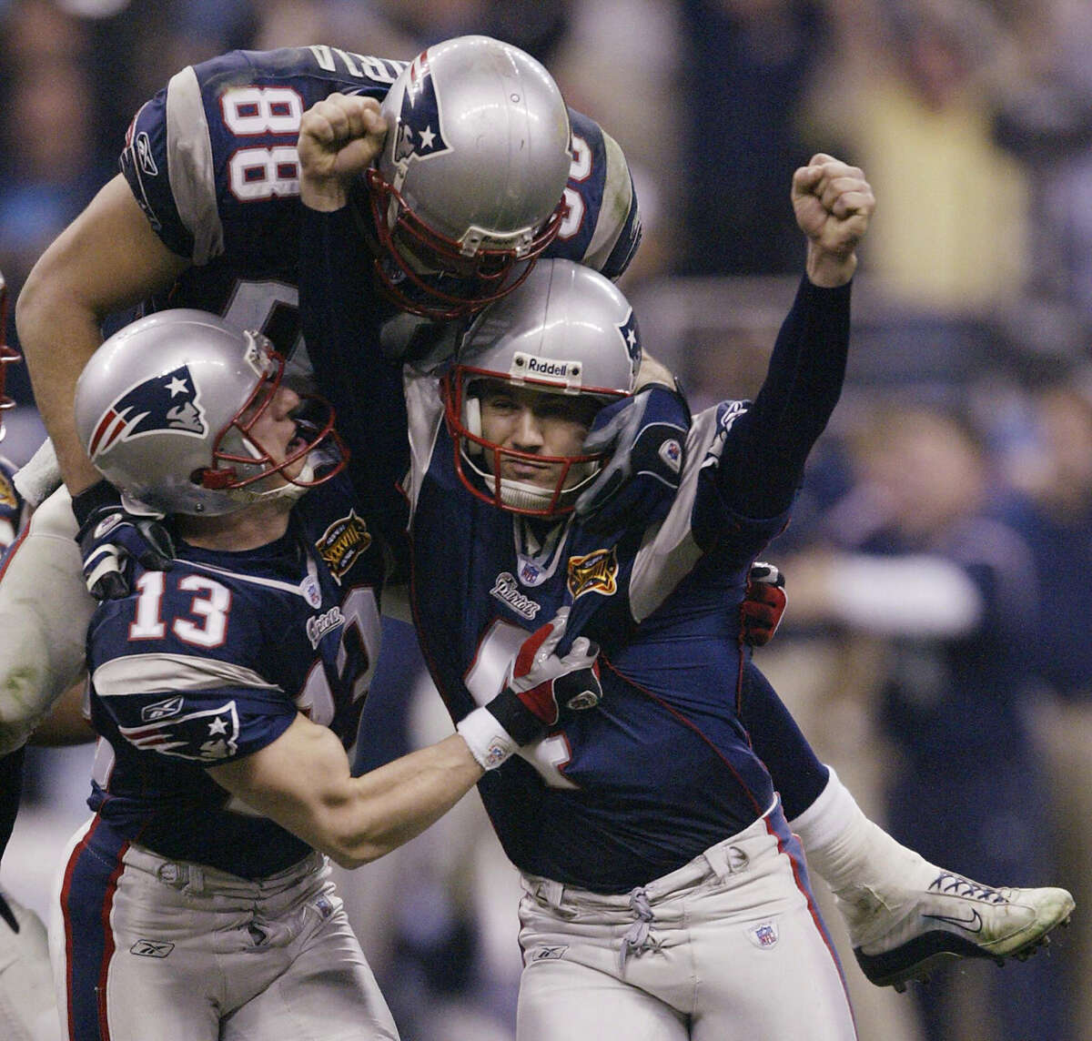 Patriots kicker Adam Vinatieri, right, celebrates after his go-ahead field goal late in Super Bowl XXXVIII against the Panthers at Reliant Stadium.
