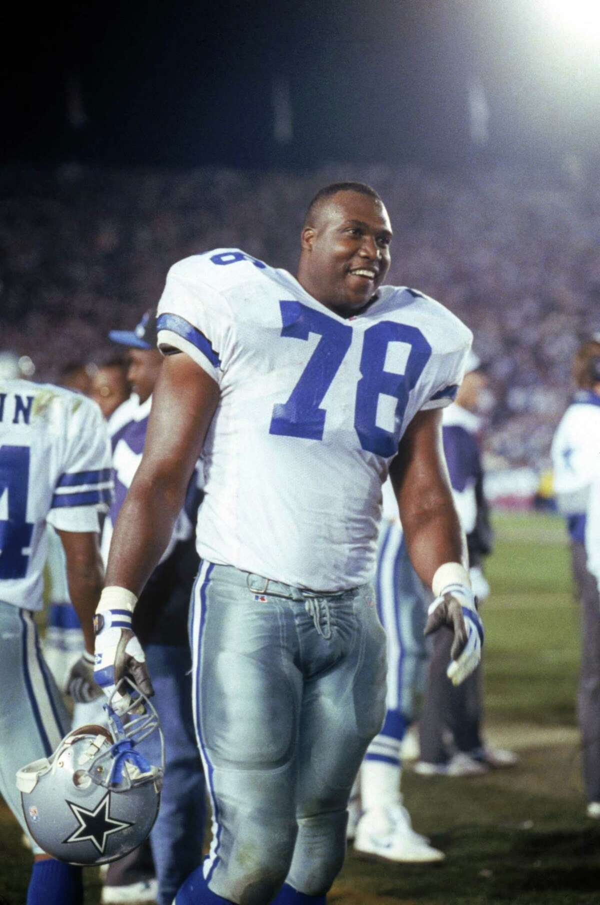 PASADENA, CA - JANUARY 31: Defensive end Leon Lett #78 of the Dallas Cowboys breaks a smiles as he stands on the sidelines during Super Bowl XXVII against the Buffalo Bills at the Rose Bowl on January 31, 1993 in Pasadena, California. The Cowboys won 52-17. (Photo by George Rose/Getty Images)