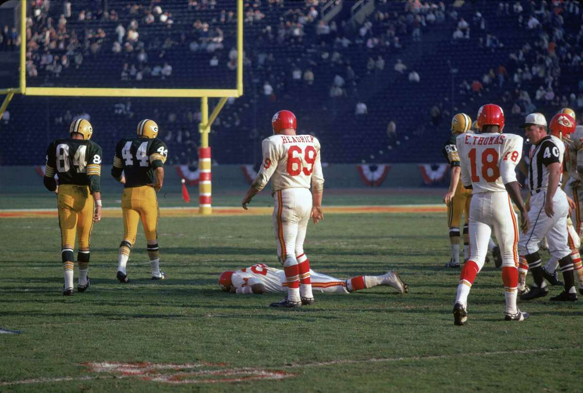 American football player Fred Williamson of the Kansas City Chiefs lies prone on the field after a collison with an opponant during the first AFL-NFL World Championships (also known as Super Bowl I) against the Green Bay Packers, Los Angeles, California, January 15, 1967. The Packers went on to win the game 35-10. (Photo by Robert Riger/Getty Images)