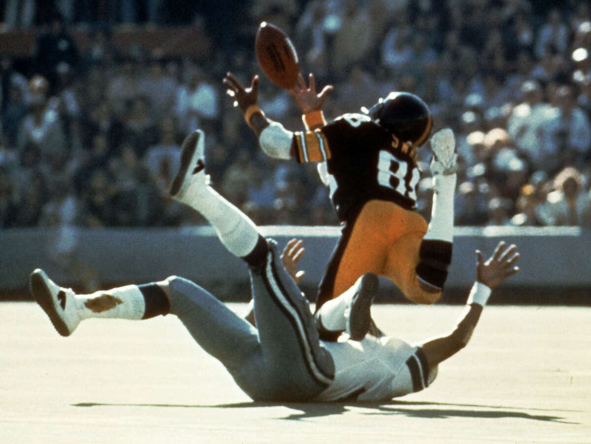 FILE--Pittsburgh Steelers wide receiver Lynn Swann (88) dives as he catches a pass from quarterback Terry Bradshaw during Super Bowl X at the Orange Bowl in this Miami, Fla., in this Jan. 18, 1976 photo. Swann was one of seven elected into the Pro Football Hall of Fame, Saturday, Jan. 27, 2001. (AP Photo/File)