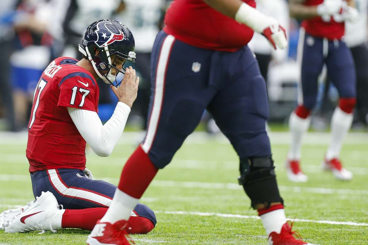 Houston Texans quarterback Brock Osweiler (17) reacts after throwing his second interception of the game during the second quarter of an NFL game at NRG Stadium Sunday, Dec. 18, 2016 in Houston. Osweiler was replaced by Houston Texans quarterback Tom Savage (3) after this play. ( Michael Ciaglo / Houston Chronicle )