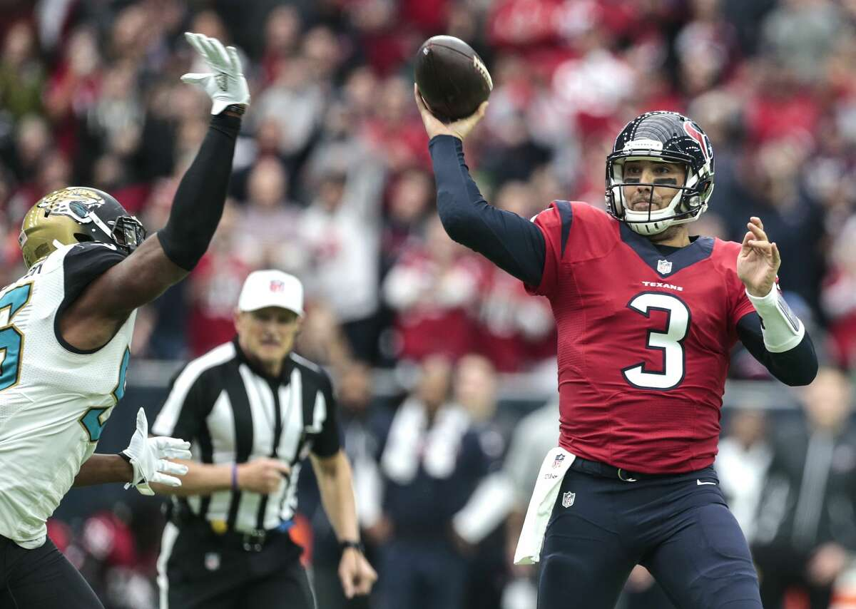 Houston Texans quarterback Tom Savage throws a pass with Jacksonville Jaguars defensive end Dante Fowler, Jr,, (56) during the second quarter of an NFL football game at NRG Stadium on Sunday, Dec. 18, 2016, in Houston. ( Brett Coomer / Houston Chronicle )