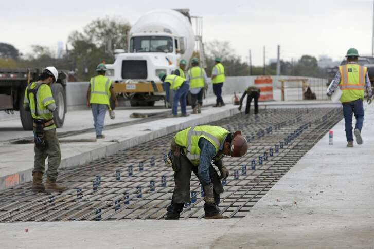 Workers tie rebar along the 290 westbound main lanes shown Tuesday, Dec. 13, 2016, in Houston. Traffic is tentatively scheduled to shift onto the new lanes on Dec. 21 from 34th to Hollister.  ( Melissa Phillip / Houston Chronicle )