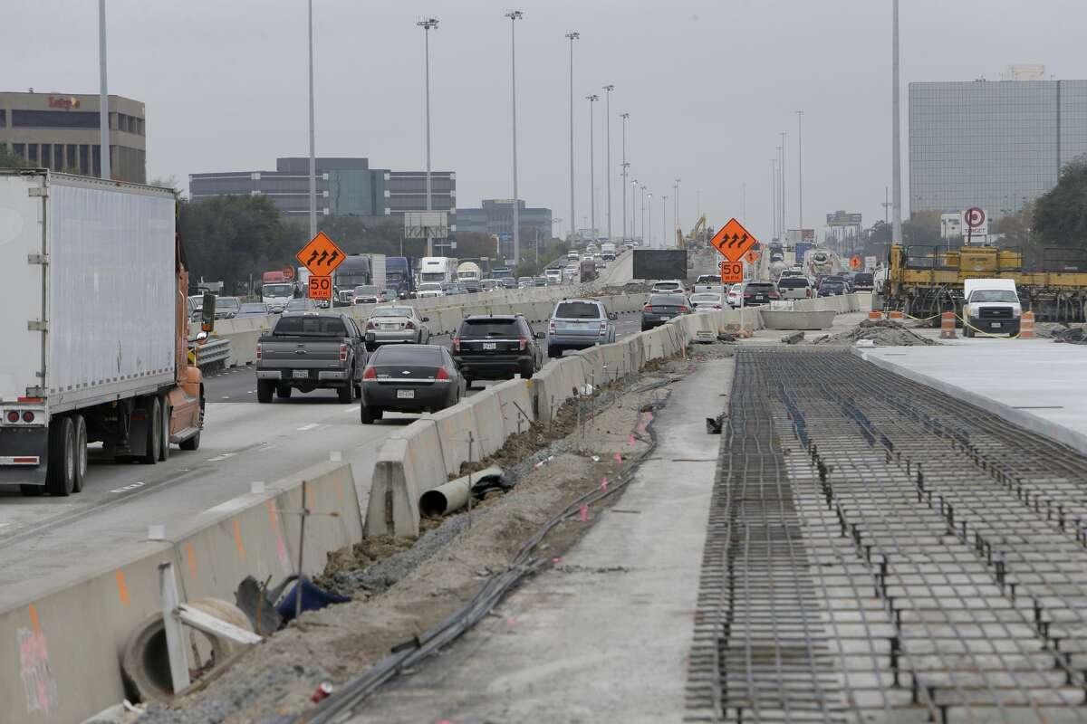Worker prepare the new westbound main lanes of U.S. 290 near Hollister on Dec. 13, 2016.