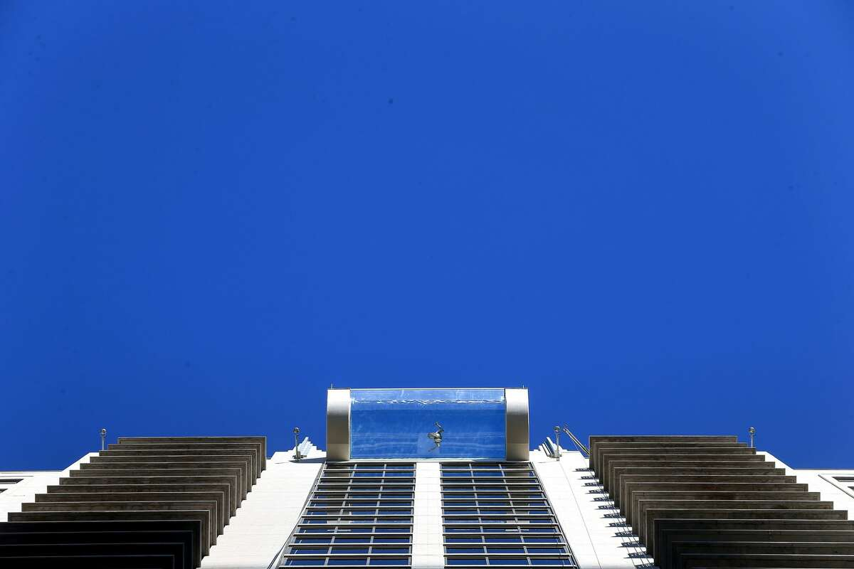 A person swims in the rooftop pool at the Market Square Tower, Tuesday, Dec. 6, 2016, in Houston. ( Jon Shapley / Houston Chronicle )