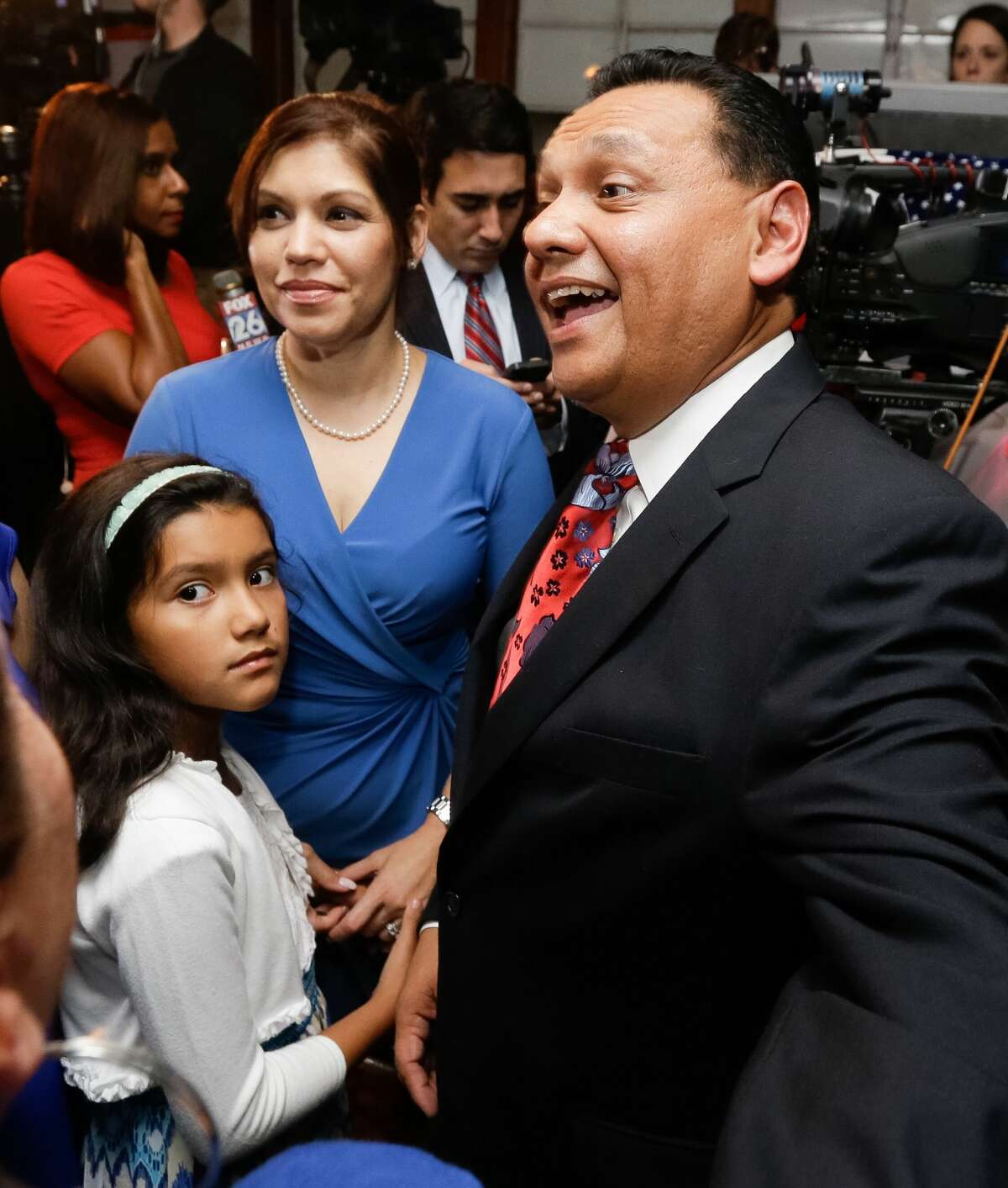 Candidate for Harris County Sheriff Ed Gonzalez, His wife Melissa, and their daughter Erika,7, are greeted by supporters during election watch party at Fitzgerald's, 2706 White Oak Dr., Tuesday, Nov. 8, 2016 in Houston. ( Melissa Phillip / Houston Chronicle )