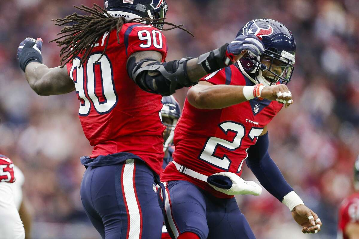 Houston Texans strong safety Quintin Demps (27) celebrates with defensive end Jadeveon Clowney (90) after Clowney sacked Jacksonville Jaguars quarterback Blake Bortles (5) on third down during the first quarter of an NFL game at NRG Stadium Sunday, Dec. 18, 2016 in Houston. ( Michael Ciaglo / Houston Chronicle )