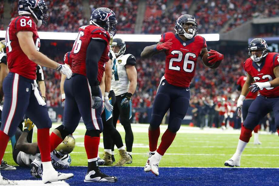 Houston Texans running back Lamar Miller (26) celebrates after running for a touchdown during the second half of the Houston Texans 21-20 win against the Jacksonville Jaguars at NRG Stadium Sunday, Dec. 18, 2016 in Houston. ( Michael Ciaglo / Houston Chronicle ) Photo: Michael Ciaglo/Houston Chronicle
