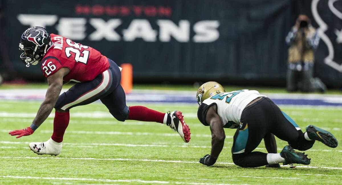Houston Texans running back Lamar Miller (26) runs the ball against the Jacksonville Jaguars during the second quarter of an NFL football game at NRG Stadium on Sunday, Dec. 18, 2016, in Houston. ( Brett Coomer / Houston Chronicle )
