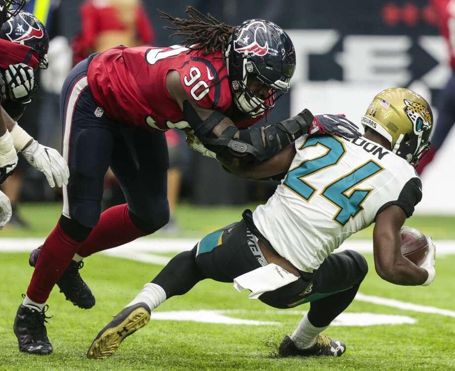 Houston Texans defensive end Jadeveon Clowney (90) stops Jacksonville Jaguars running back T.J. Yeldon (24) for a loss during the fourth quarter of an NFL football game at NRG Stadium on Sunday, Dec. 18, 2016, in Houston. ( Brett Coomer / Houston Chronicle ) Photo: Brett Coomer/Houston Chronicle