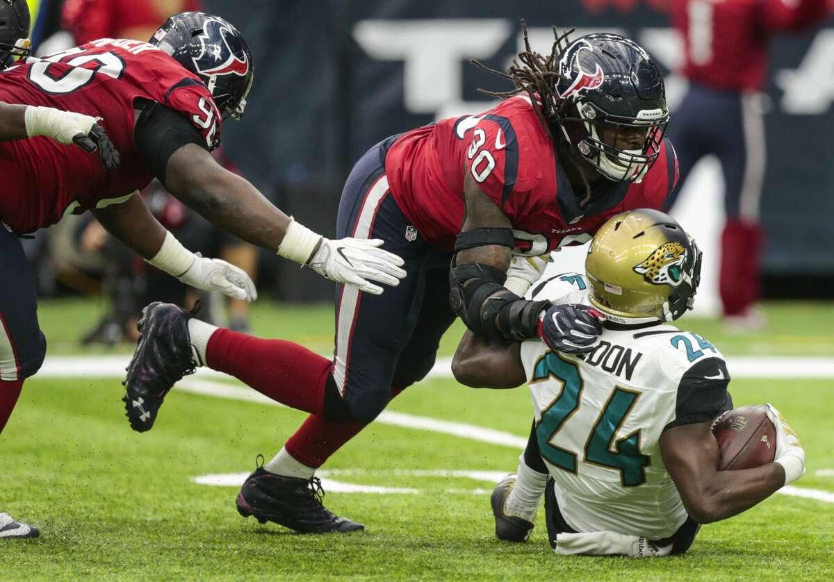Houston Texans defensive end Jadeveon Clowney (90) stops Jacksonville Jaguars running back T.J. Yeldon (24) for a loss during the fourth quarter of an NFL football game at NRG Stadium on Sunday, Dec. 18, 2016, in Houston. ( Brett Coomer / Houston Chronicle )
